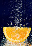 Slice of orange with water drops Royalty Free Stock Photography