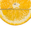 Slice orange in water on white background Royalty Free Stock Photography