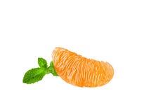 A slice of orange on white background. A slice of peeled orange isolated on white background Royalty Free Stock Photos