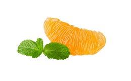 A slice of orange on white background. A slice of peeled orange isolated on white background Stock Image