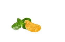 A slice of orange on white background. A slice of peeled orange isolated on white background Stock Images