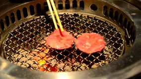 Slice ox tongue on hot charcoal grill pan stock footage