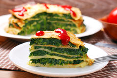 Slice of pancake cake with spinach Royalty Free Stock Image