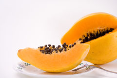 Slice Papaya Fruit with Seeds Stock Images