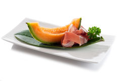 Slice Parma Ham And Melon On Dish Stock Photo