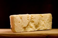 Slice of Parmesan cheese Royalty Free Stock Images