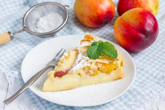 Slice of peach clafoutis Royalty Free Stock Image