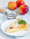 Slice of peach clafoutis Royalty Free Stock Images
