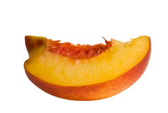 Slice of peach isolated on white stock image