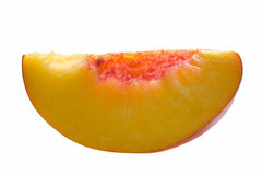 Slice of peach isolated on white. Slice of peach on white background Stock Image