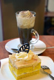 Slice of pear cream cake and cup of viennese coffee Stock Images