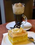 Slice of pear cream cake and glass cup viennese coffee Royalty Free Stock Photos
