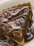 Slice Of Pecan Pie With Caramel Sauce And A Fork Stock Photos