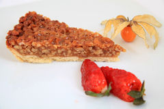 A slice of pecan pie with decoration Royalty Free Stock Photography
