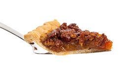 A slice of pecan pie on white Royalty Free Stock Photography
