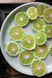lime in green fresh sliced on white plate. Royalty Free Stock Images