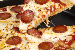 Slice of pepperoni pizza Royalty Free Stock Photos
