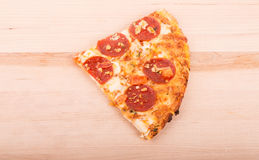 Slice of Pepperoni Pizza on a Wood Cutting Board Stock Photos