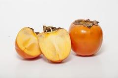 Slice persimmon on white background. Orange persimmon on white background Stock Images