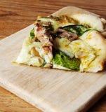 Slice of pesto pizza Royalty Free Stock Photo