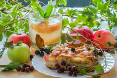 Slice of pie and glass of compote Royalty Free Stock Photo