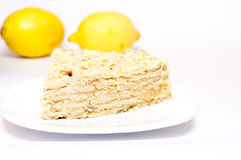 Slice of pie with lemons, focus is on the front of the cake. Slice of pie with lemons in the background, focus is on the front of the cake Stock Images