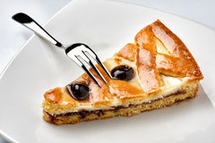 Slice pie ricotta sour cherry plate sweet fork Royalty Free Stock Photos