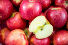 Slice piece of apple with group of red apples Stock Photography