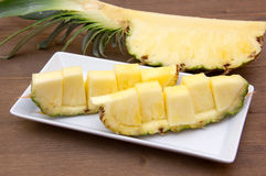 Slice of pineapple cut on wood Royalty Free Stock Photography