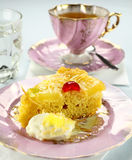 Slice Of Pineapple Upside Down Cake. Fresh baked pineapple upside down cake with glace cherries Royalty Free Stock Image
