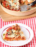 Slice of Pizza. Slice of sausage and mushroom pizza on a plate stock images