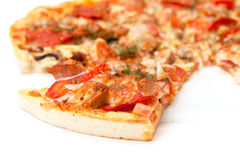 Slice of Pizza. Closeup on white background stock image