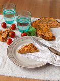 A slice of pizza. On a plate Royalty Free Stock Image