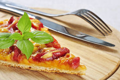 Slice of pizza. With knife and fork on wooden cutting board stock photos