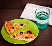 Slice of pizza. On the plate Royalty Free Stock Photos