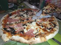 Pizza prosciutto with mushrooms and ham royalty free stock images