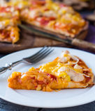 Slice of pizza with chicken, corn, tomatoes and double cheese Stock Photos
