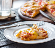 Slice of pizza with chicken, corn, tomatoes and double cheese Stock Images