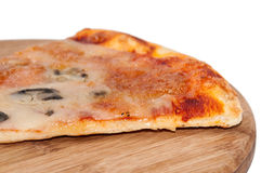 Slice of pizza on a kitchen wooden board Royalty Free Stock Photography