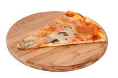 Slice of pizza on a kitchen wooden board Stock Photos