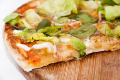 Slice of pizza with letuce Royalty Free Stock Photography