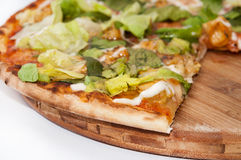 Slice of pizza with letuce.  Stock Photo