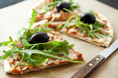 Slice of Pizza Margherita with Arugula and Olives Royalty Free Stock Photo