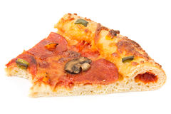 Slice of pizza with a missing bite Stockbild