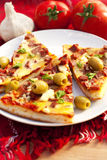 slice of pizza with olives and tomatoes Royalty Free Stock Images