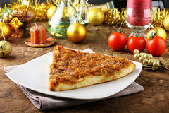Slice of pizza with onions Stock Images