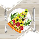 A slice of pizza on a plate. Next to a knife and fork Royalty Free Stock Photo