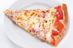 Slice of pizza on plate Stock Images