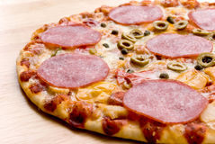 Slice of pizza salami with cheese,vegetables Stock Photos