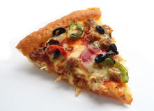 Slice of pizza supreme over white Royalty Free Stock Image